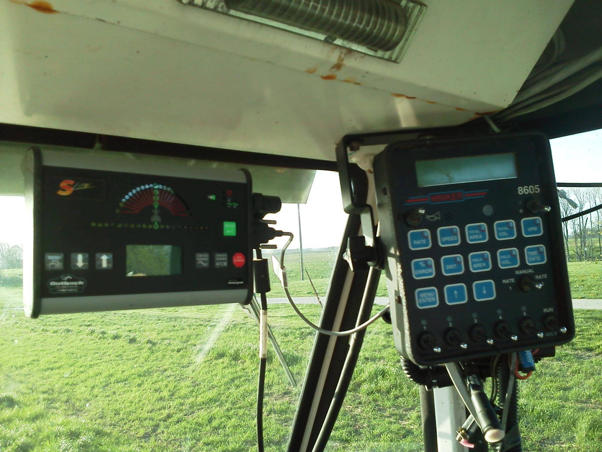 The Hiniker spray controller is connected to an Outback GPS lightbar with Auto Mate.