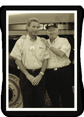 Two of AGCO Corp.'s founding fathers, John Shumejda, CEO, and Bob Ratliff, chairman, proudly show off AGCO's newest tractor. On January 4, 2002, Shumejda and Ed Swingle, AGCO's vice president of marketing, were killed in a plane crash in England.