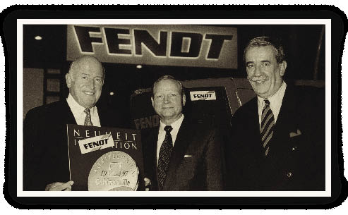 In 1997, AGCO added German tractor Fendt to its growing list of farm equipment brand names. Bob Ratliff, Georg Bickeleiter and Hermann Merschrot (l-r) of Fendt display the gold medal awarded to Fendt for its Vario transmission.