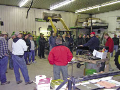 "Don Hoover, owner of Binkley & Hurst, gives a hands-on presentation in the shop during a planter clinic. Hoover recommends keeping the clinic brand-neutral. ""We have brought many competitive planter owners to our events, built relationships with them, sold them our services, accessories, attachments, etc., then transitioned them to our brand of planter when the buyer's cycle afforded the opportunity,"" he says."