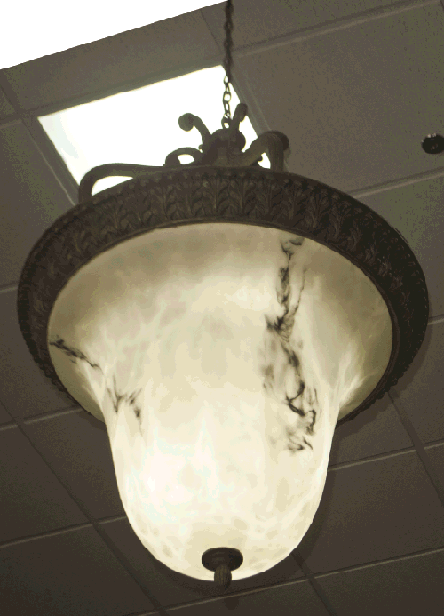 The antique chandeliers that light the new showroom