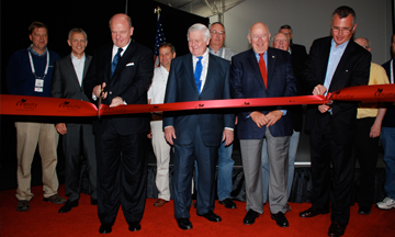 Martin Richenhagen, chairman and CEO, and Bob Crain, senior vice president and general manager, AGCO North America, cut the ribbon opening Intivity Center in Jackson, Minn., assisted by honored guests Al McQuinn, founder of Ag Chem Corp.,  and Bob Ratliff, one of the original founders of AGCO in 1990.