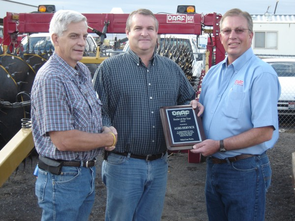 Karl Almquist, general manager of Nikkel Iron Works, presents the DARF Top Dealer Award to Doug Ottersberg, general sales manager of Agri-Service, along with Brett Mathie, area sales representative for Nikkel Iron Works.)