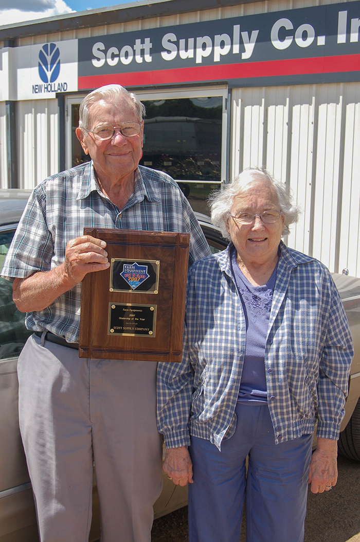 Wally Scott and his wife, Gladys, in 2007 showing off Farm Equipment's Dealership of the Year award.